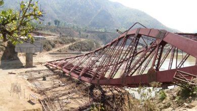 Photo of धादिङमा बन्दै गरेको पक्की पुल हुरीले भत्कायो